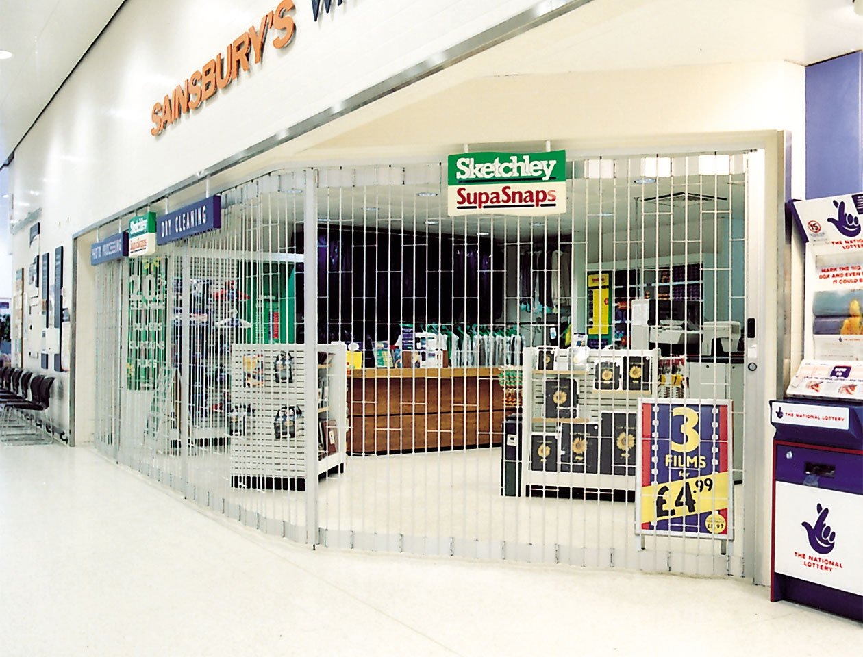 ali glyde sliding foliding grille used by sainsburys supermarket