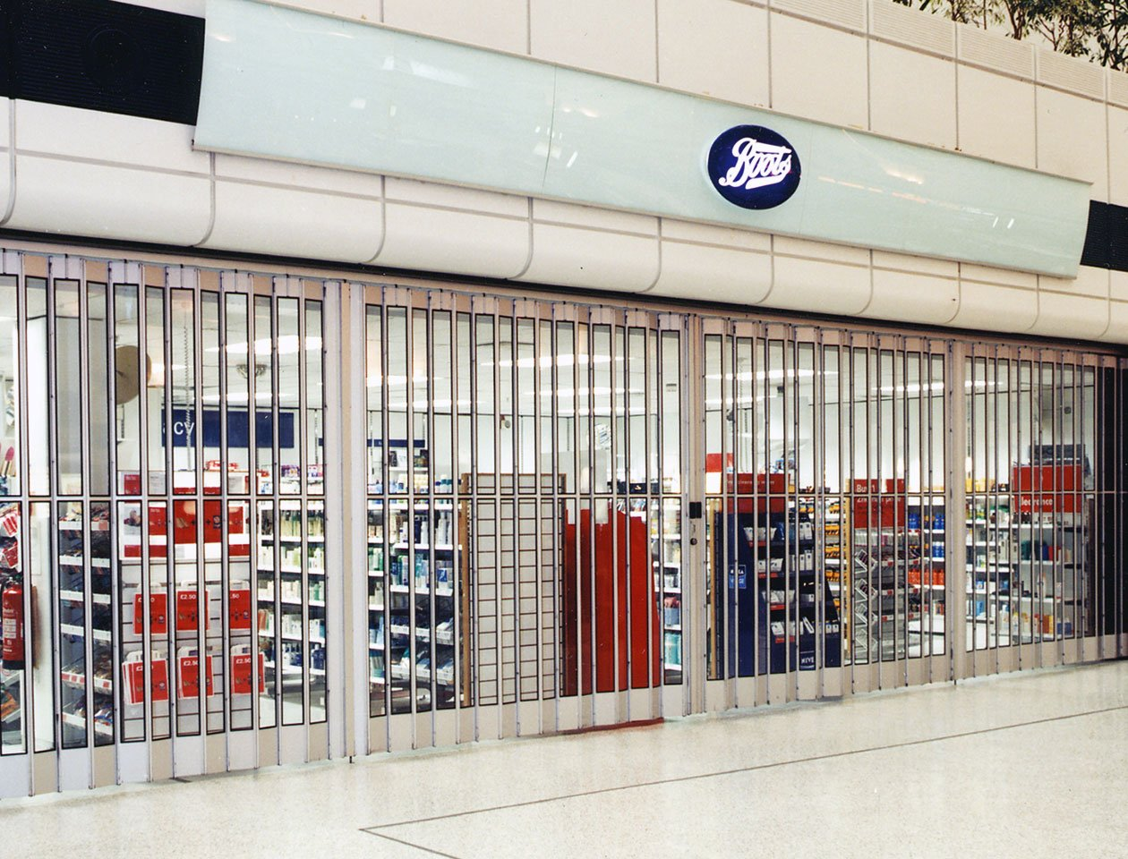 aluminium sliding shutters used by Boots pharmacy