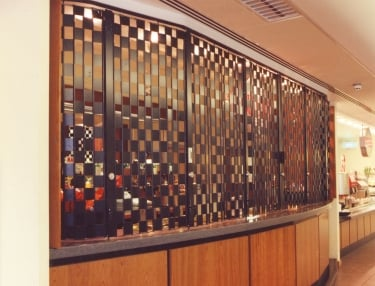 ali glyde sliding grille used at a food court