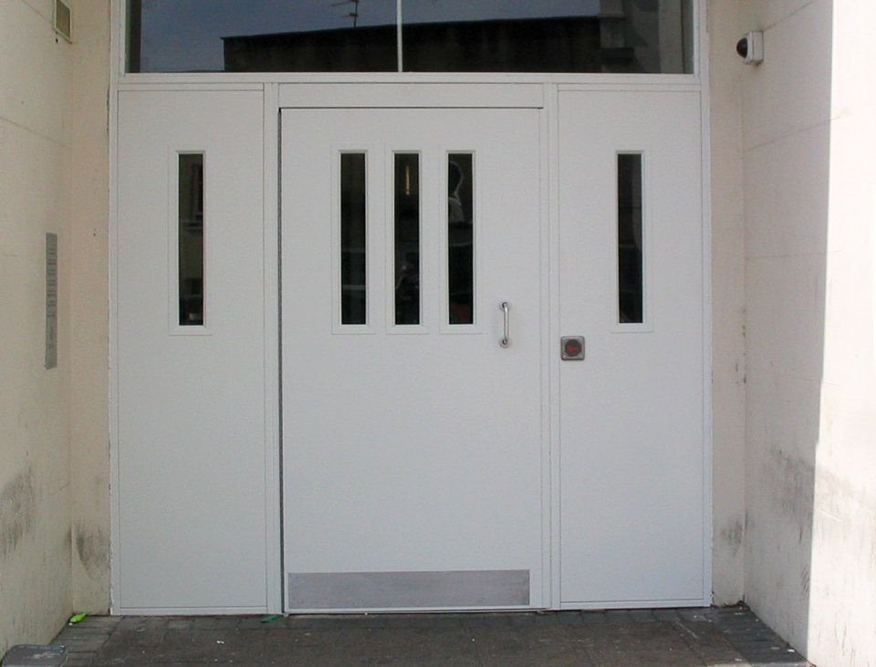 communal entrance steel security doors in white