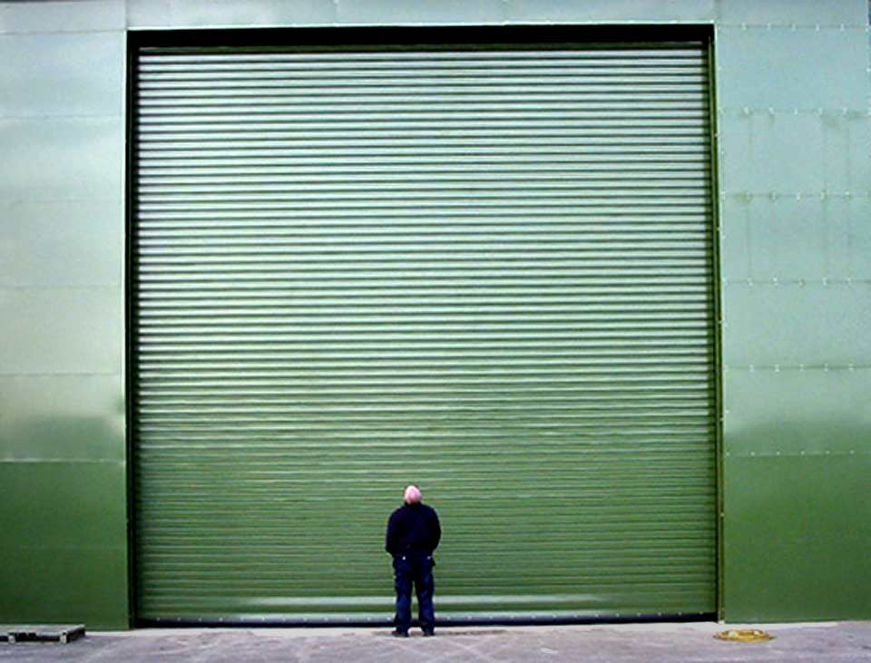 image of large green industrial roller shutter door