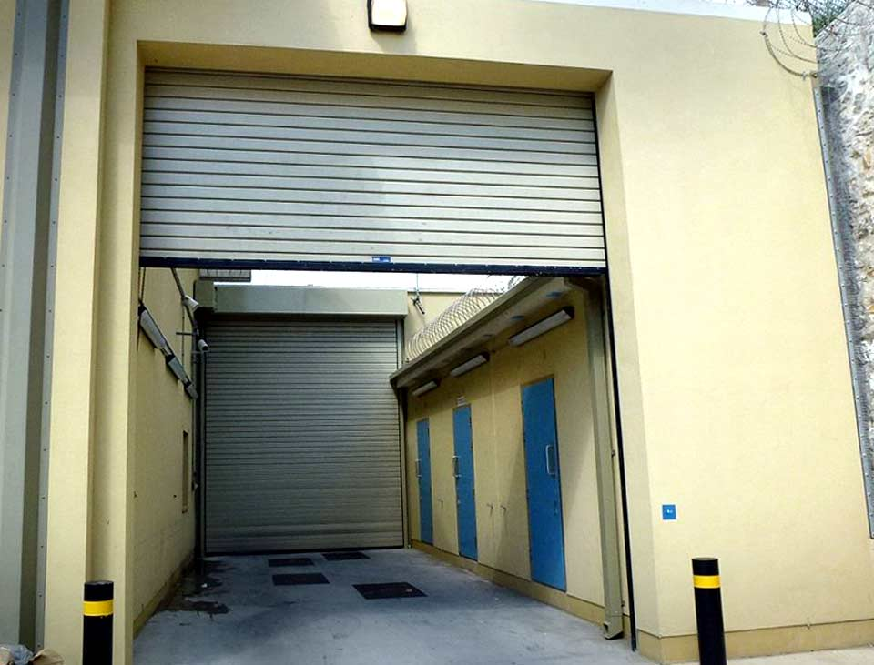 f1 industrial roller shutter door from armour guard range in situ at a prison