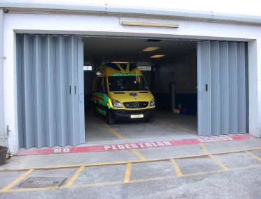industrial roller door with ambulance behind