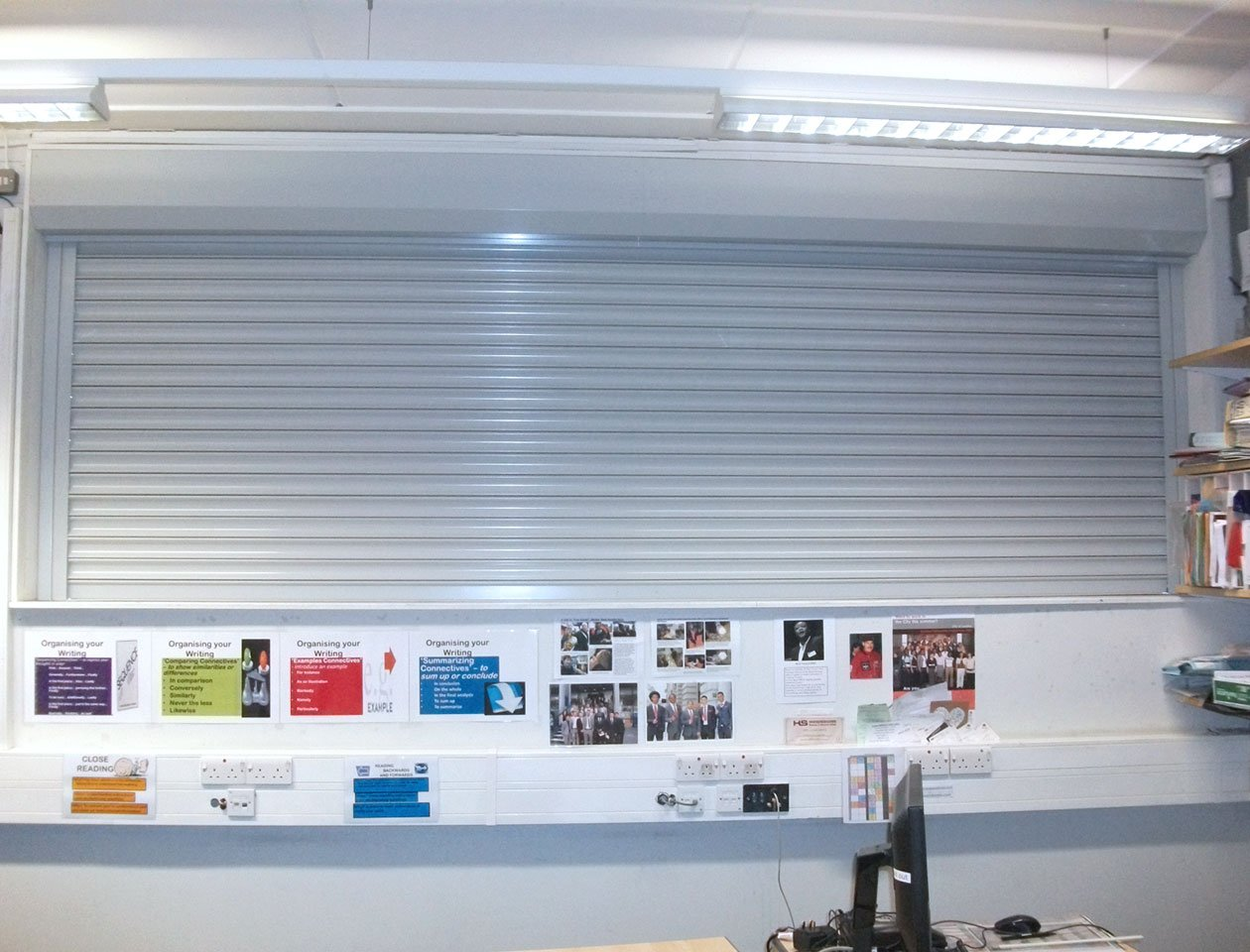 Fire shutter with silver finish in use in hallway
