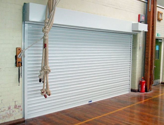 fire roller shutter in white used in a school